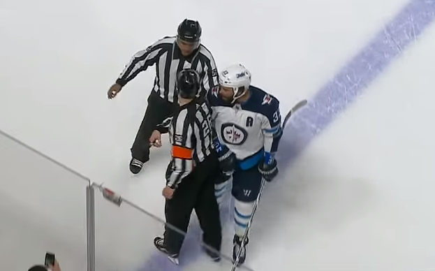 Dustin Byfuglien bumps referee