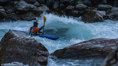 Garen Stephens, enjoying another classic class 4 rapid, Upper Marsyangdi river blue water kayak rocks WhereIsBaer.com Chris Baer