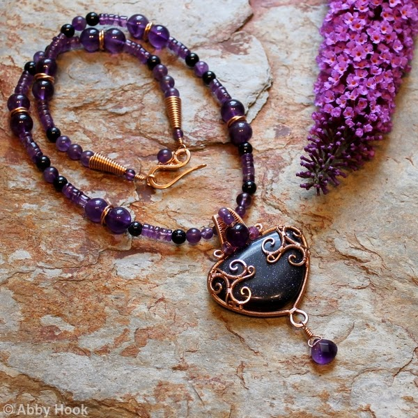 http://www.abbyhook.co.uk/bronze-jewellery/483194_celtic-inspired-triskelion-necklace-bronze-with-blue-goldstone-and-amethyst.html