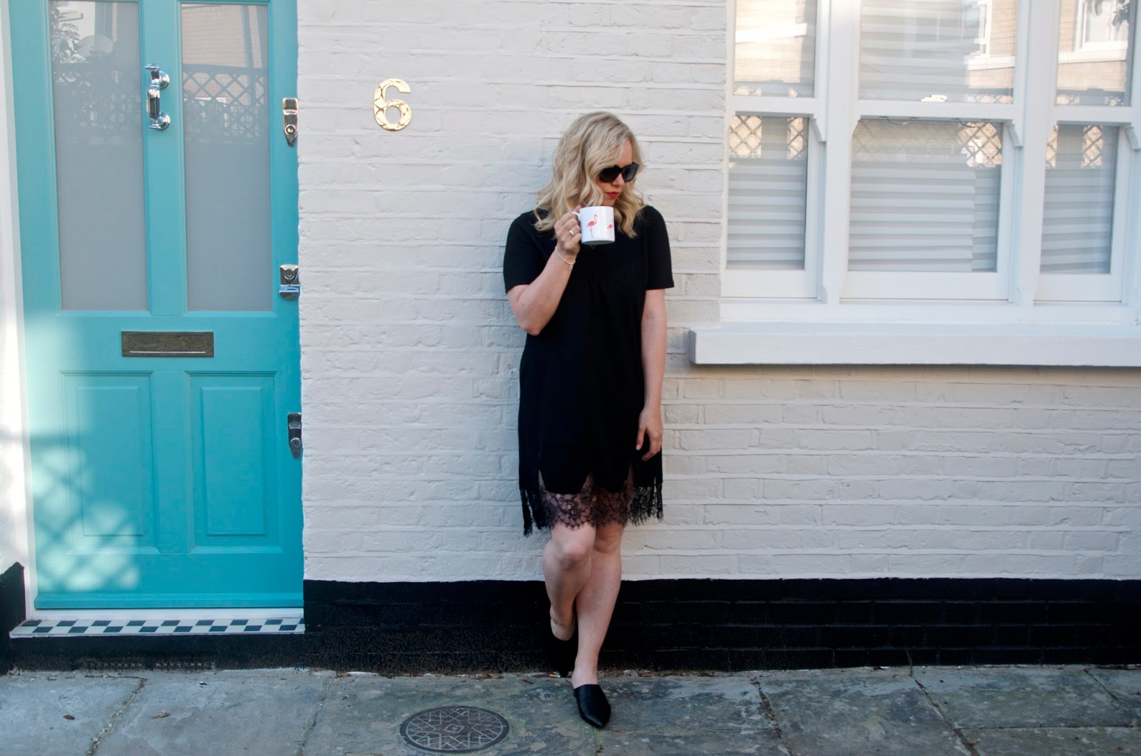 Black lace dress and pink flamingo coffee cup with tiffany blue door