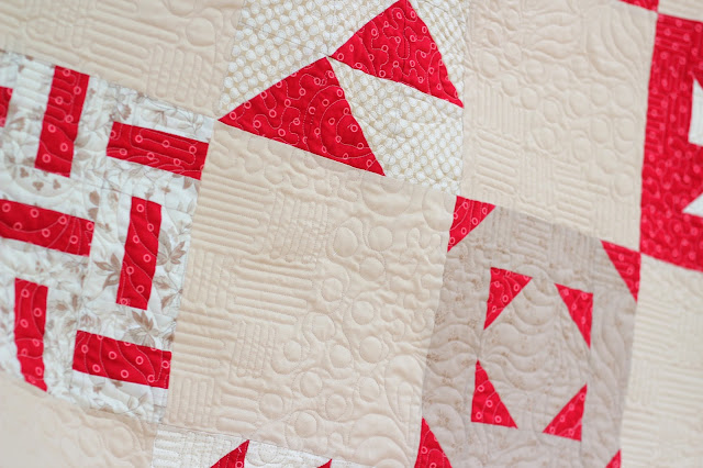 Red and cream sampler quilt with quilting pattern called Textures