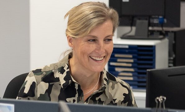 During her visit, the Countess of Wessex wore a camouflage shirt dress by French Connection