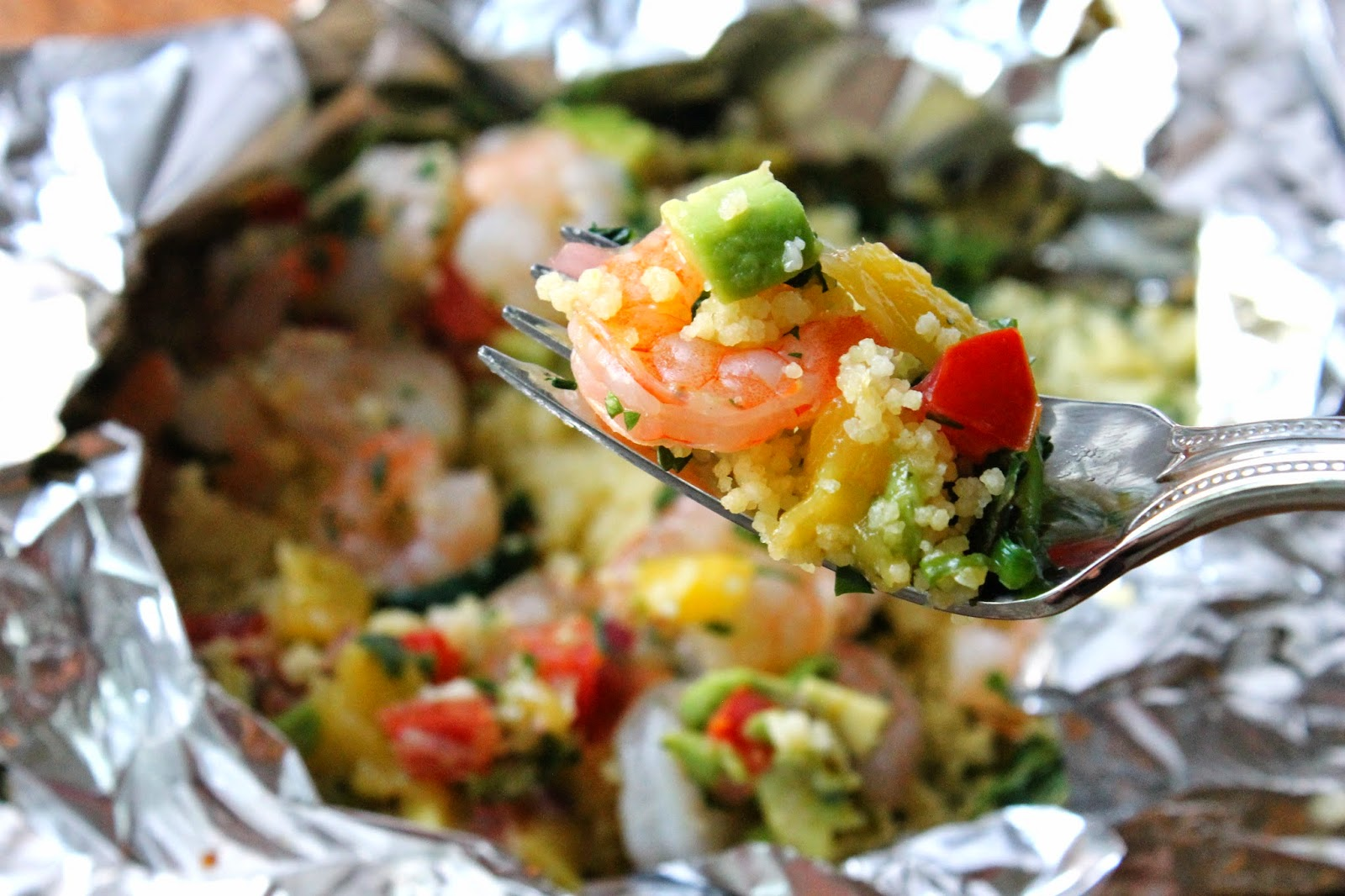 Shrimp and couscous packets with avocado-mango salsa