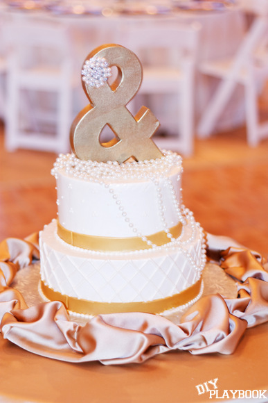 This ampersand cake topper is gold and unique.