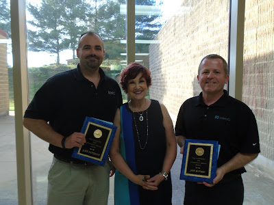 EMC Corporation's Jamie Patterson (left) and Joey Richard (right) received the Tri-County 2016 Community Service Award from Cooperative Education Director Mary-Ellen MacLeod for their contributions to the Tri-County community.