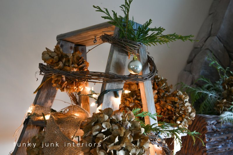 a treeless ladder christmas tree decorated with twig garland and hydrangeas by funky junk