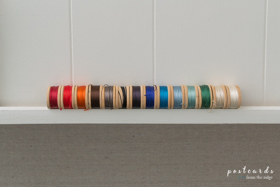 colorful vintage wooden spools of thread