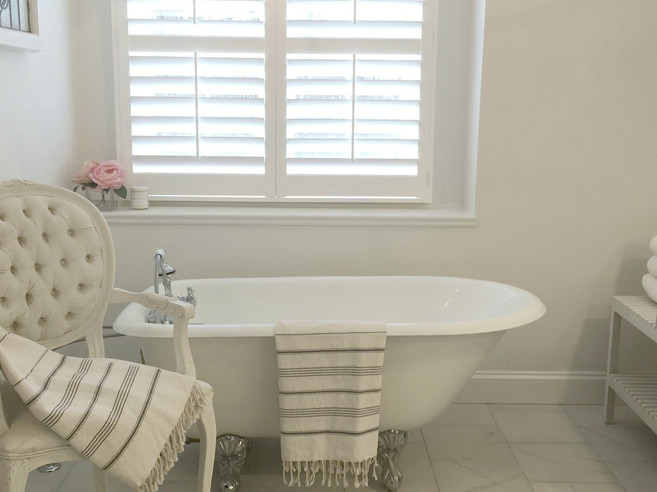 Clawfoot Tub in Master Bathroom in Chicagoland fixer upper by Hello Lovely Studio. Come see renovation photos in Before & After: My Home Renovation.