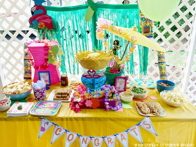 luau party ideas, congrats banner, flamingo, leis, grass skirt, outdoor party