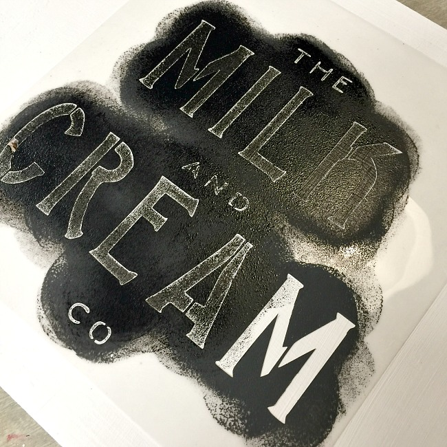Black paint for a stenciled milk and cream tray.