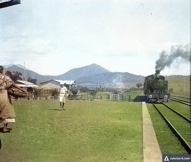 A railroad train in Batangas c. 1930.  Image source:  University of Wisconsin at Milwaukee Digital Library.  Colorized courtesy of Algorithmia.