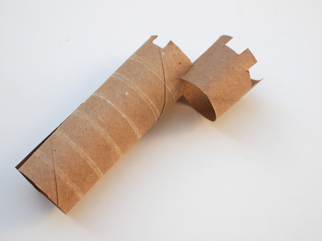 create an asymmetric cardboard roll tower for your castle