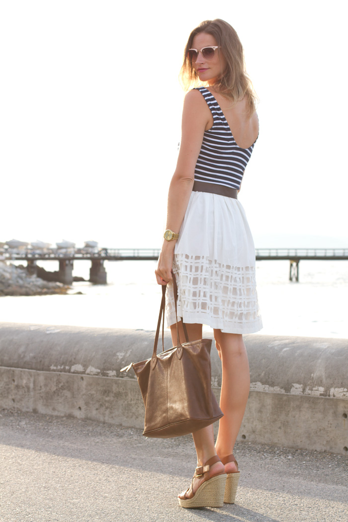 Vancouver Fashion Blogger Alison Hutchinson, is wearing a Mink Pink navy blue striped bodysuit, Club Monaco laser cut midi skirt, Michael Kors wedge espadrilles, and a One Fated Knight Marquess Bag