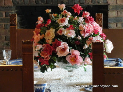 fresh roses in Bourn Cottage dining room at Empire Mine State Historic Park in Grass Valley, California