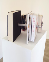 Silver chrome Barbell with books; Jeff Koons, Nicolas Machiavelli, Friedrich Nietzsche, Diogenes of Sinope, Sun Tzu, Baruch Spinoza, Socrates, Pascal ,Aristotle, Voltaire, Platon and Pablo Picasso, Andy Warlhol, Ai Weiwei,Jackson Pollock, Jean-Michel Basquiat.