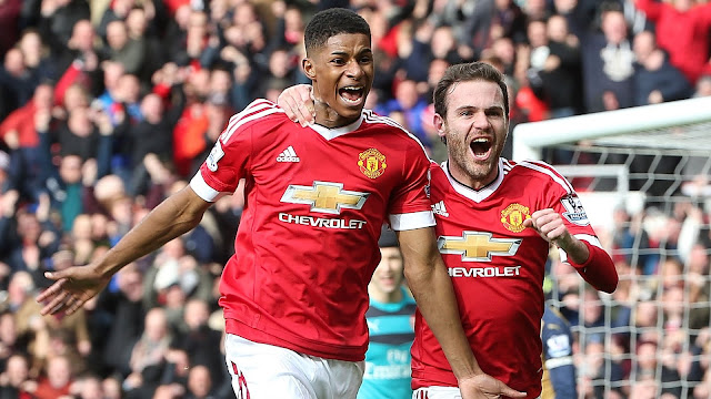 Rashford (left) celebrates with Juan Mata after scoring for United