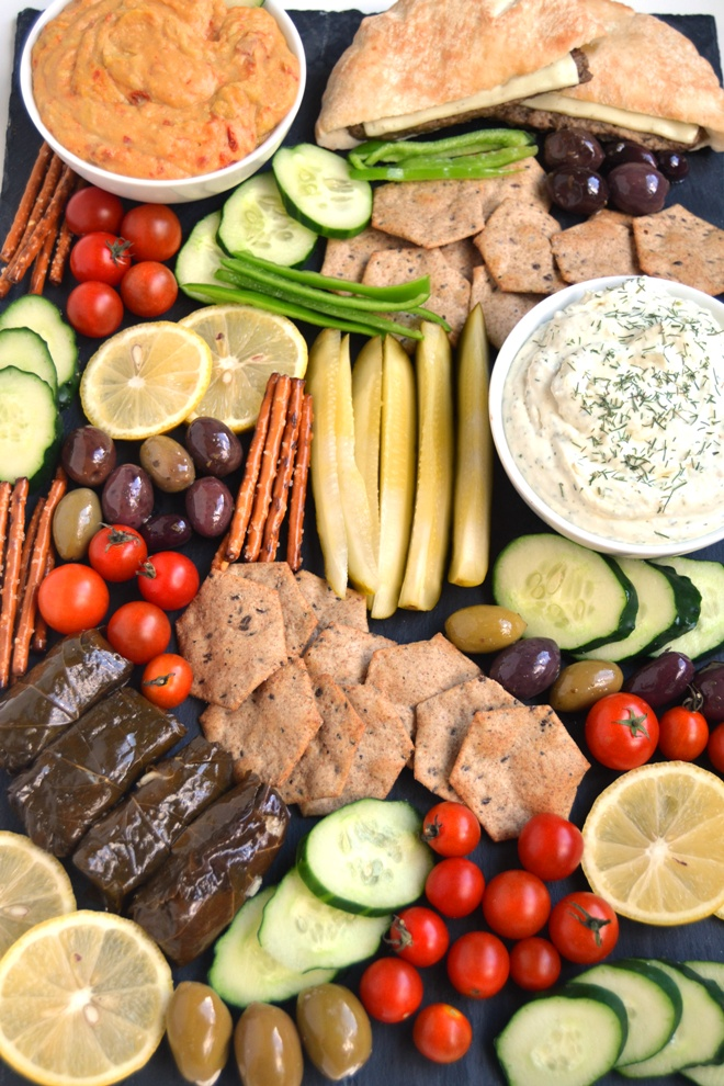 Greek Appetizer Platter is super easy to make with homemade Lemon, Feta and Dill Dip, Greek olives, tomatoes, grape leaves, hummus, pickles, peppers, gyro sandwiches and more. All ready in 10 minutes! www.nutritionistreviews.com