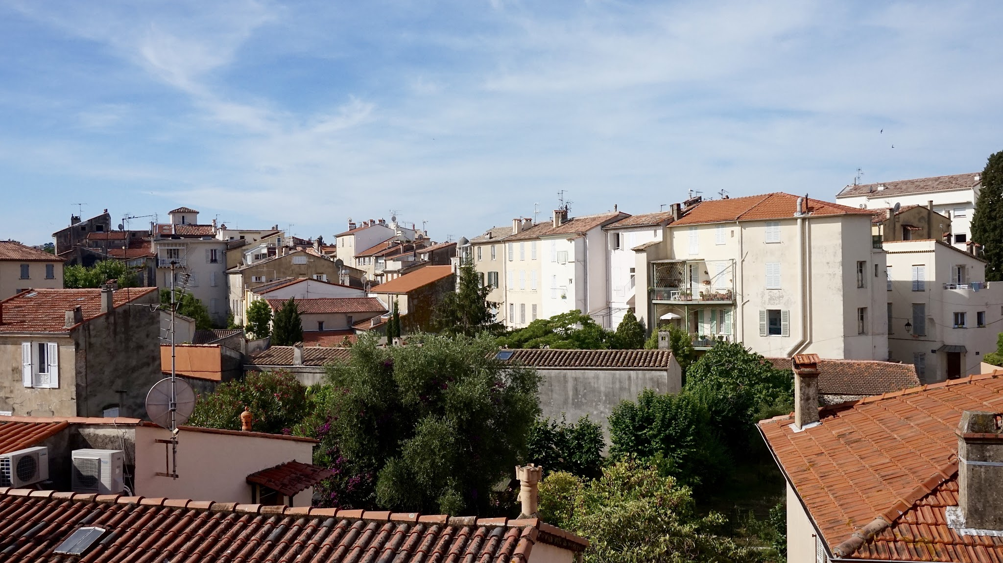 a view over rooftops, blue sky