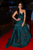 Raashi Khanna in Dark Green Sleeveless Strapless Deep neck Gown at 64th Jio Filmfare Awards South ~  Exclusive 022.JPG