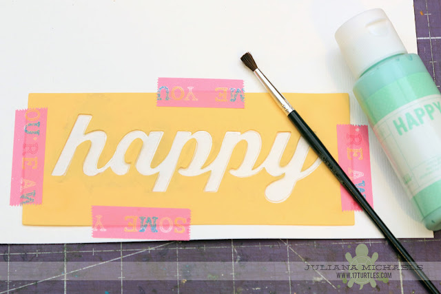 Tutorial for creating a handmade scrapbook page title using a stencil, modeling paste and acrylic paint by Juliana Michaels featuring Jillibean Soup Stencils and Happy Hues Paint