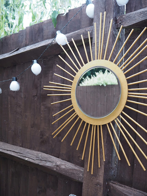 DIY tutorial sunburst outdoor mirror using mirror candle plate and wooden dowels from hobby raft