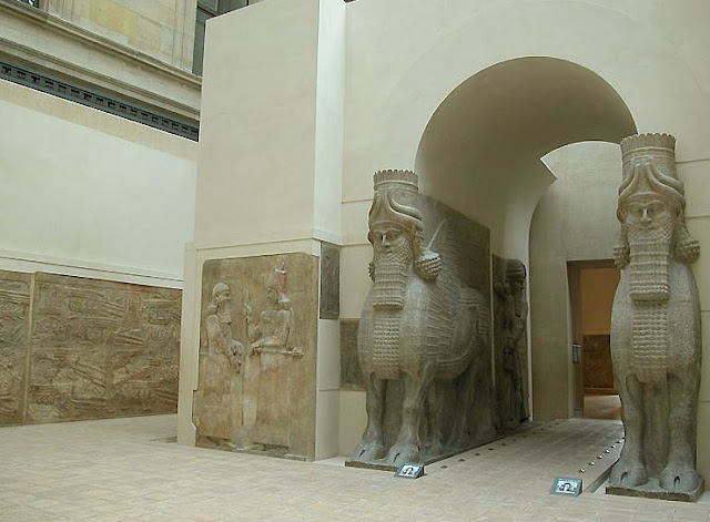 https://en.wikipedia.org/wiki/Lamassu#/media/File:Human-headed_Winged_Bulls_Gate_Khorsabad_-_Louvre_02aa.jpg