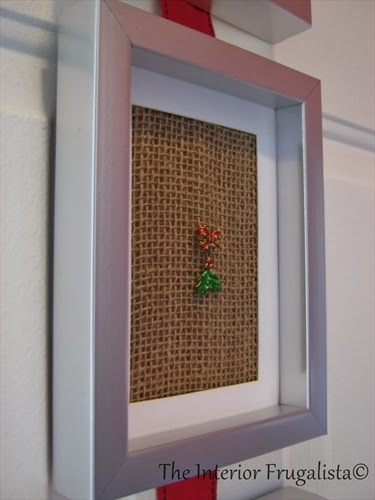 Attached an old Mistletoe Brooch to burlap and placed in a frame