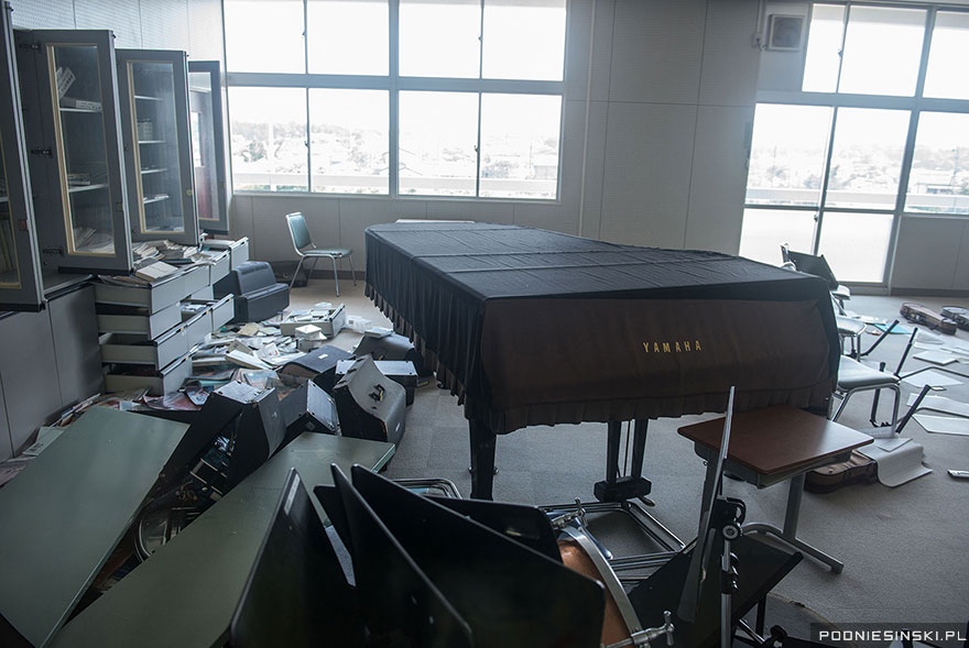Musical instruments including a piano litter the floor of this classroom - Never-Before-Seen Images Reveal How The Fukushima Exclusion Zone Was Swallowed By Nature