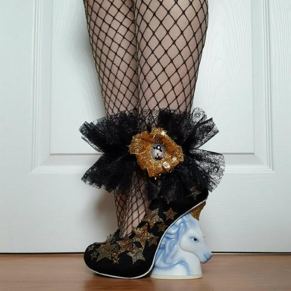 black ruffled lace ankle cuff worn with gold star shoes with unicorn heel