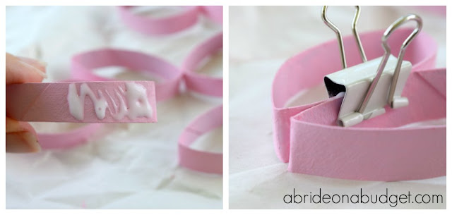Who loves upcycling?  Check out these cute DIY heart escort cards made from toilet paper rolls by www.abrideonabudget.com.