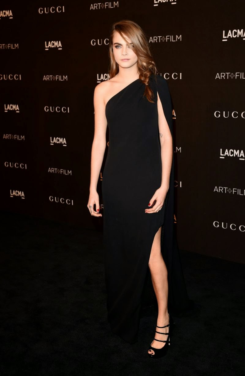 Cara Delevingne sizzles in a black one shoulder gown at the 2014 LACMA Art + Film Gala