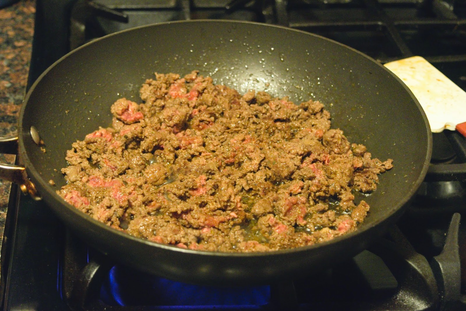 The ground beef browning in the pan.