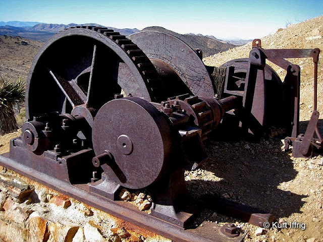 This winch is mounted on the hill behind the stamp mill. The remains of a glory hole can be found further up.
