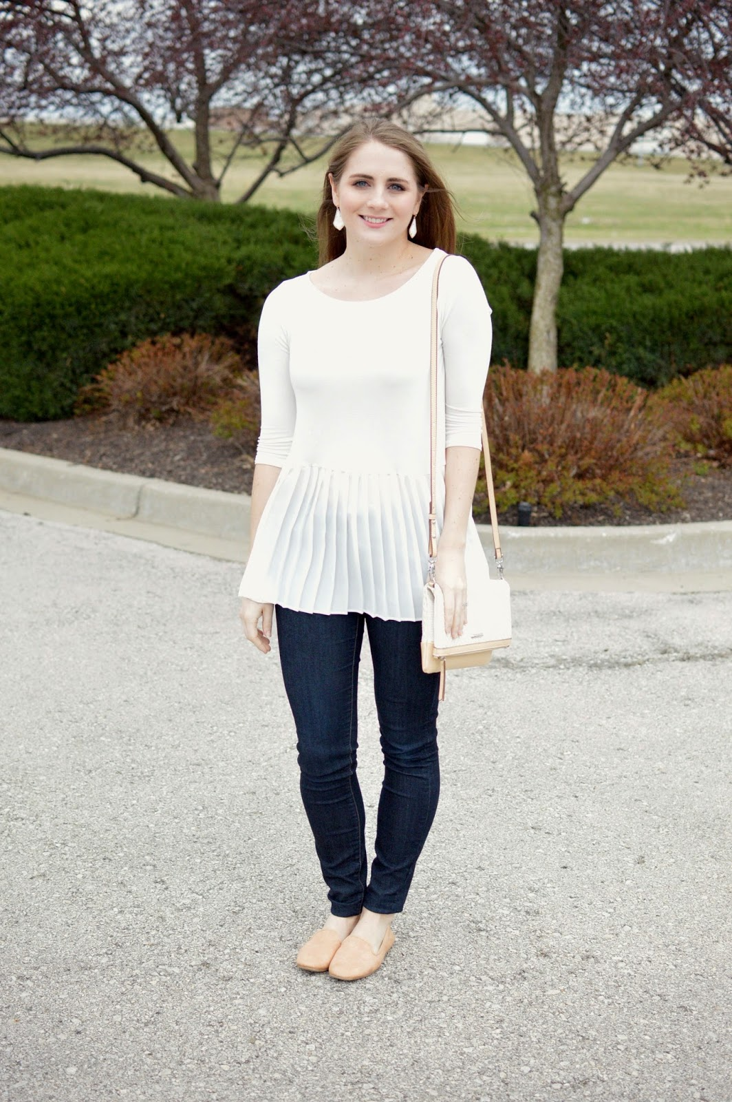 white top with nude loafers for spring