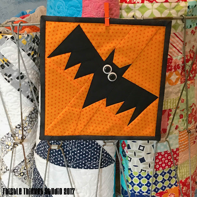 Halloween Bat Mini Quilt Made By Thistle Thicket Studio. www.thistlethicketstudio.com