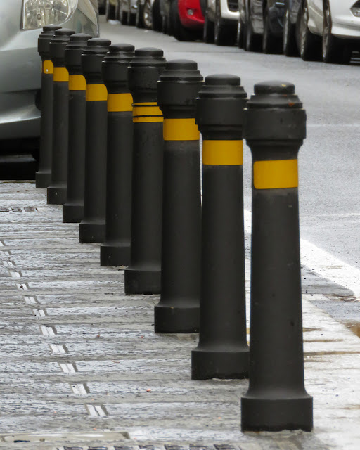 Bollards in a row, Via Michon, Livorno