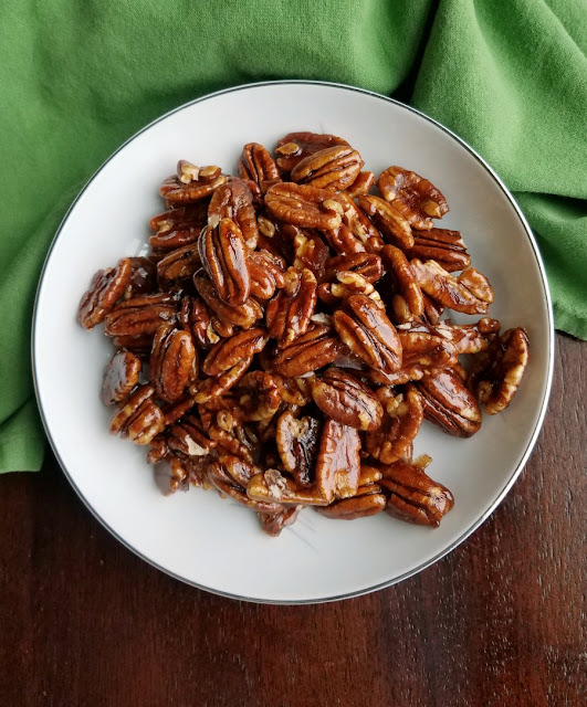 bowl of shiny candied pecans