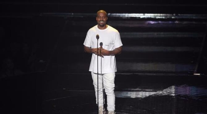 What happens when you give Kanye West four minutes to do whatever he chooses?  That was the question heading into Sunday's VMAs after reports that producers gave the polarizing pop disrupter the green light to do whatever he wanted onstage.  So what did he do? He emerged onstage and approached a podium and immediately began to pay tribute to, well, himself.