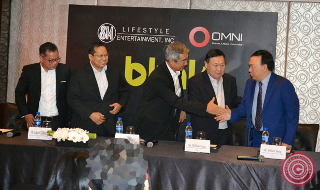 the signing of Memorandum of Understanding between SMLEI and Omni Digital Media Ventures Inc in Edsa Shangri-la, Batanes Tower wing on December 4, 2014