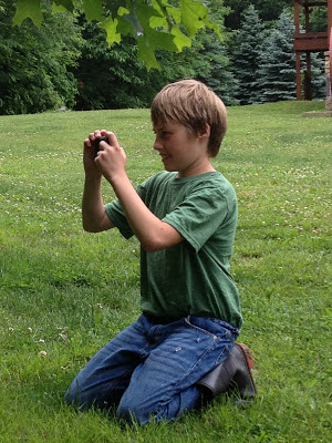 young gardener taking pictures