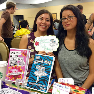 Amber and Melanie with a display of their zines