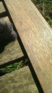 Showing the before and after scrubbing the bench with wire wool.