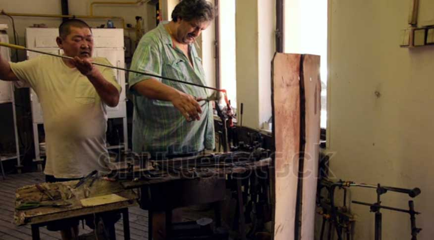 Glass blower is tasked with designing and shaping glass into various shapes