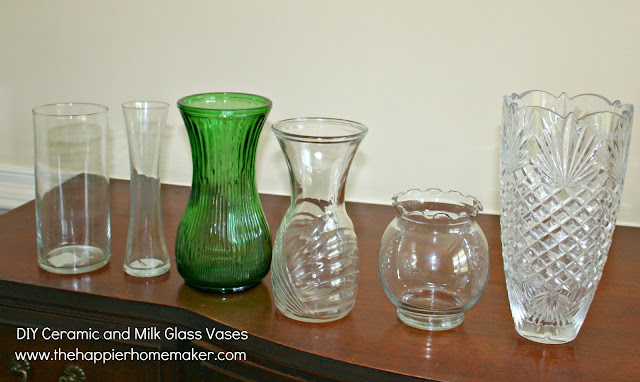 Several vases that are clear or colored before being painted white