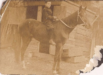 Unidentified boy on a horse from Slade collection