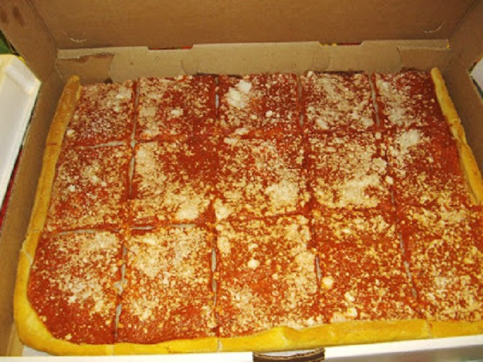 this is a tomato pie from Utica New York Napoli's bakery my son brought home for a gift  for Christmas