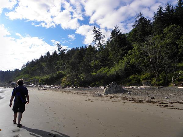 Bruce on Third Beach, walking towards bright sunshine