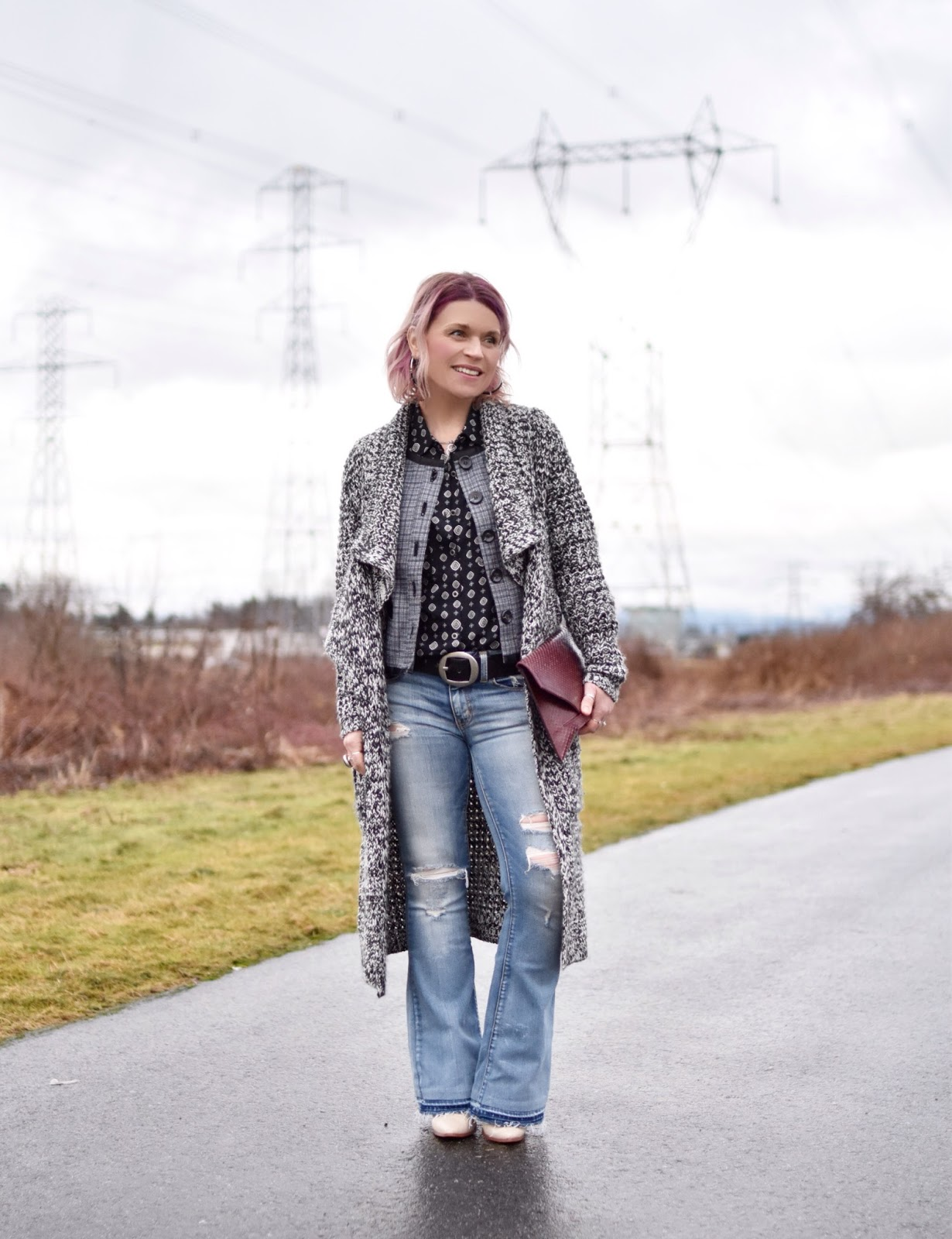 Monika Faulkner outfit inspiration - styling a patterned shirt with distressed flare jeans, a Chanel-inspired jacket, and a long cardigan