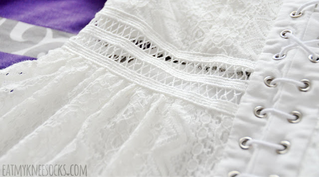Details on the cream white three-quarter sleeve lace crochet lace-up front cutout flared skater dress from SheIn.