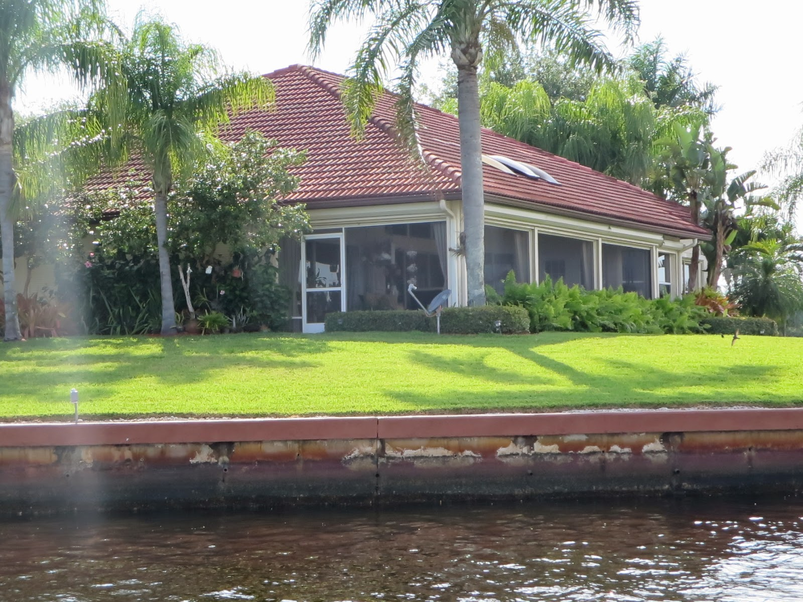 House along a channel at the edge of the Florida Everglades